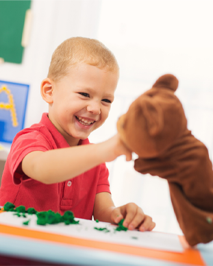 boy playing with a puppet